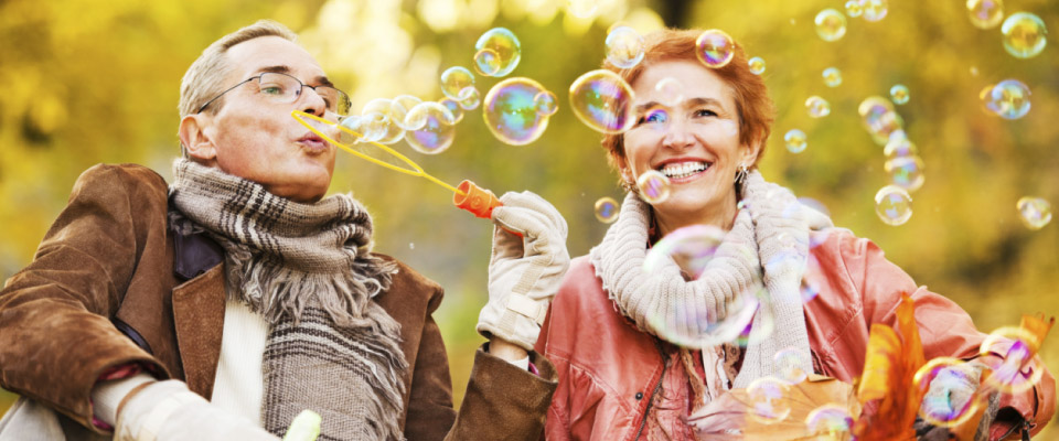 couple blowing bubbles