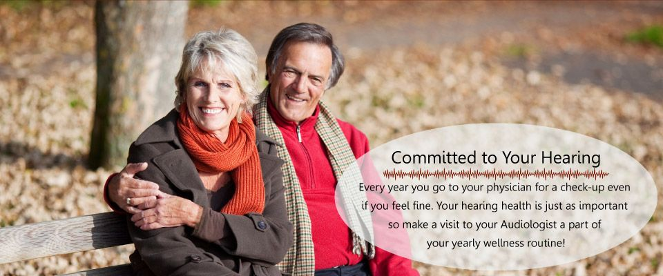 Committed to Your Hearing | Smiling couple