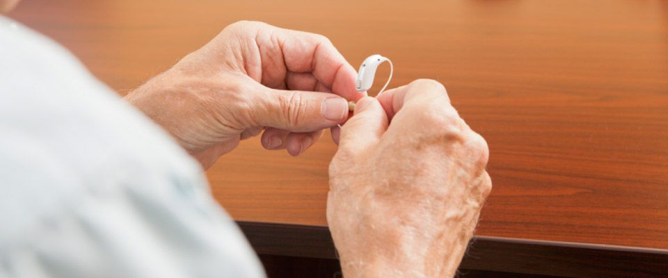 holding hearing aid